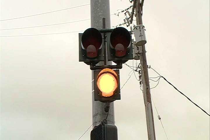 First, the bottom light starts flashing yellow.