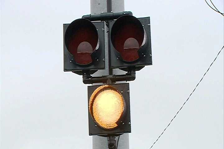The flashing yellow light is followed by a solid yellow light.