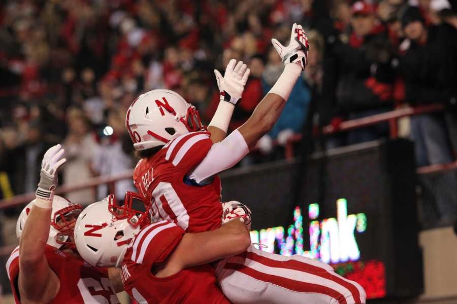 Kenny Bell gets hoisted after scoring a touchdown.