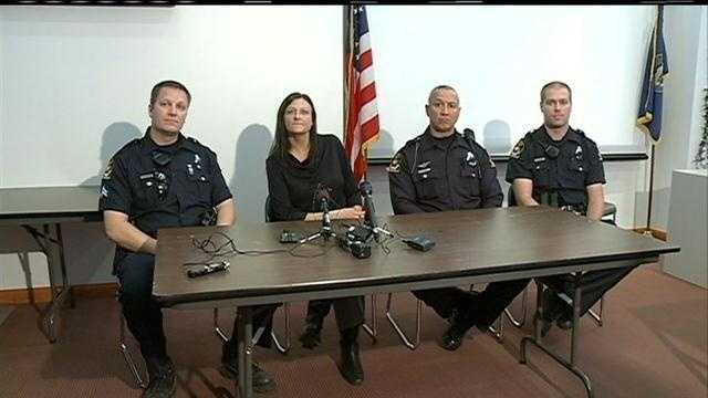 Omaha police officers dove into a cold lake Sunday and rescued two people and their dog when a boat capsized.
