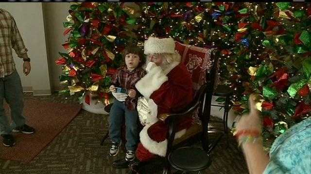 Autistic children are treated to a special visit with a 'sensory Santa', in an environment sensitive to their unique needs.