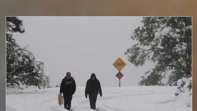 Snow people walking 120612