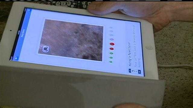 A man calls 911 when he notices an intruder in his apartment via a webcam.