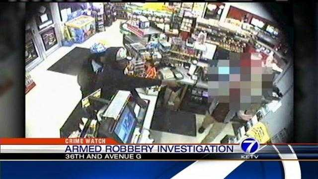 Police are searching for a man and woman accused of holding up a convenience store at gunpoint.