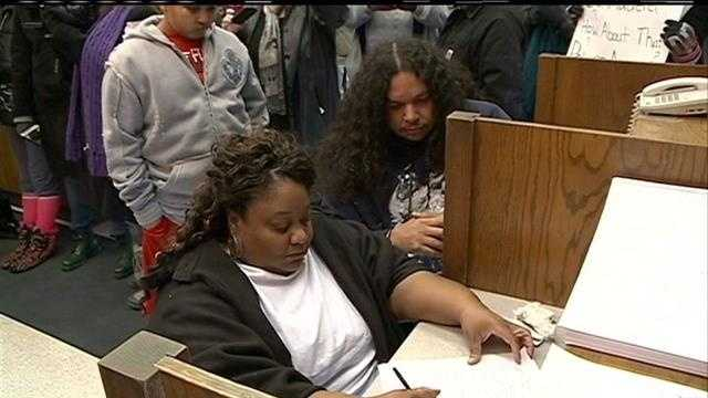 Dozens of people gathered Sunday to support an Omaha mother in filing a complaint against police abuse.