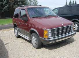 """Her first car was a red Plymouth minivan. """"All red. Even the interior, top to bottom."""""""