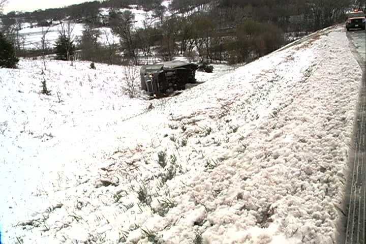 Wintry conditions may have caused a semitruck to slide off Interstate 680 near Missouri Valley on Thursday morning.