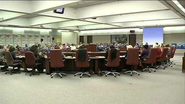Dozens of families gathered inside Omaha Public Schools headquarters Monday in a fight to keep their school principal.