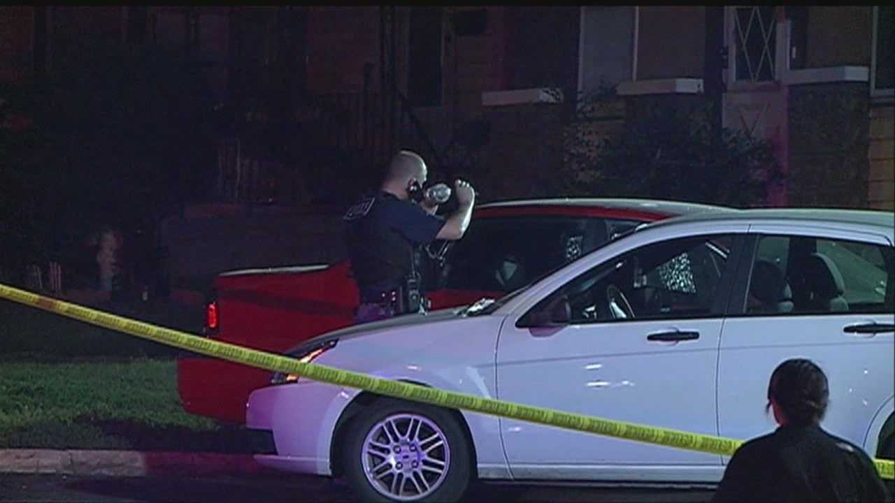 Police respond to what is originally referred to as an accident in a gas station parking lot to find two men shot inside the car.  One is dead, the other is in critical condition.