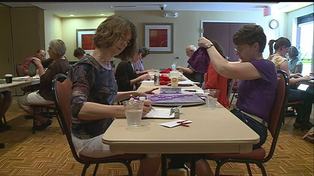 Dozens of people squared off Sunday in a tournament that took more brains than brawn, where if you could spell with speed, you could be named the best Scrabble player in Omaha.