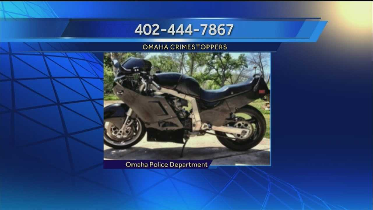 A pedestrian suffered a broken arm when he was involved in a hit-and-run crash with a motorcycle overnight in Omaha.