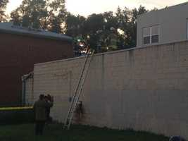 Investigators at the scene where Kruger's vehicle was found searched a nearby building's roof. Deputies were seen with two bags of evidence.