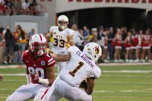 Husker Kenny Bell pursues Wyoming's Jalen Claiborne on a punt return.