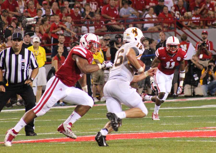 Husker defenders chase down a Wyoming player.