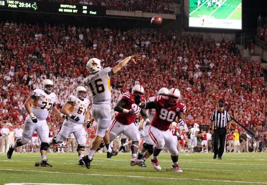 Brett Smith launches a pass over the Husker line.