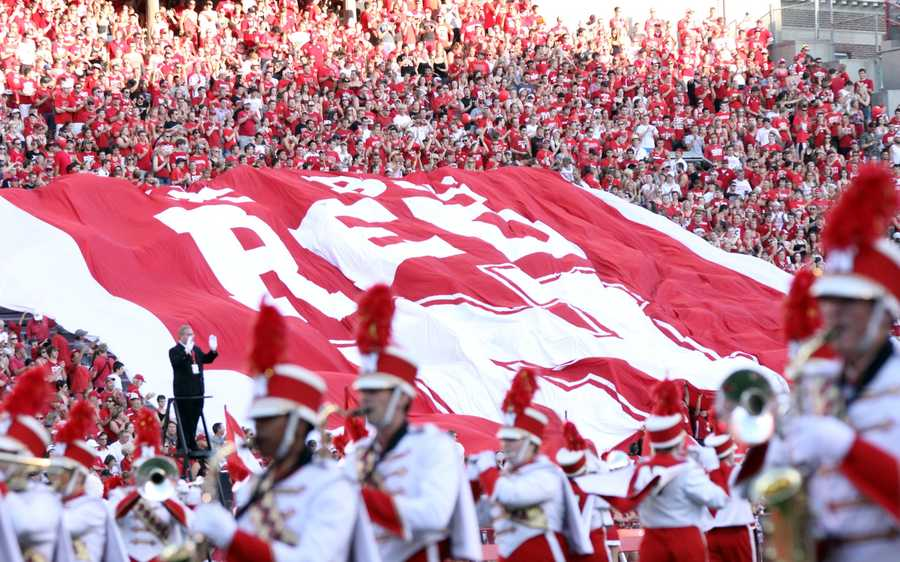 "As the band played the pregame show, the Sea of Red showed their pride with the giant ""Go Big Red"" banner."