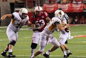 Brett Smith runs from the Husker defense.