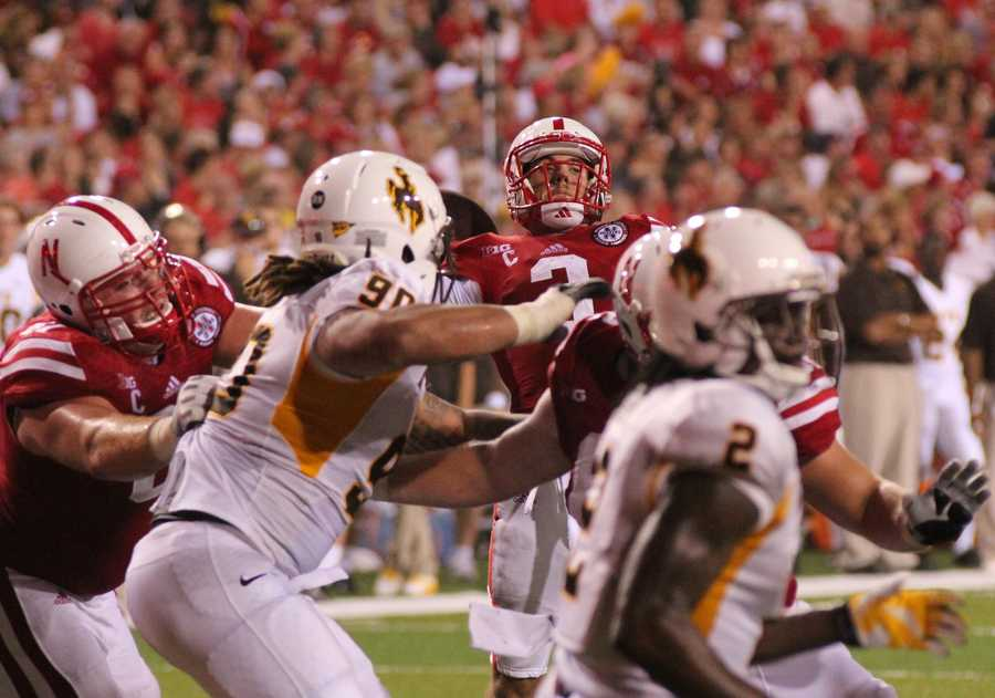 Husker quarterback Taylor Martinez lofts a touchdown fade during the third quarter of play.