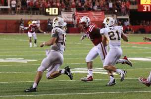 Husker David Santos closes in on the Wyoming quarterback.