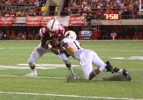 Husker Kenny Bell comes down with a grab against Wyoming.