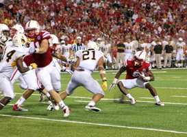 Nebraska junior I-Back Ameer Abdullah makes a cut against Wyoming.