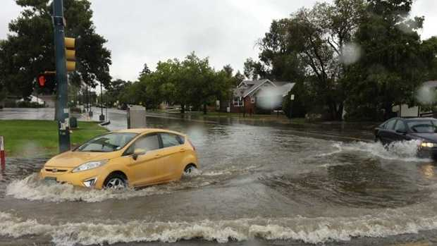Drivers brave flooded roads in one Colorado town.