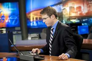KETV NewsWatch 7's Jeremy Maskel at the anchor desk monitoring damage reports.