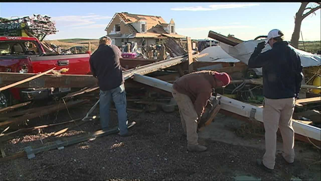 A tornado carves a path of destruction through Woodbury County in Iowa.  One Moville resident shares her story and surveys the damage.