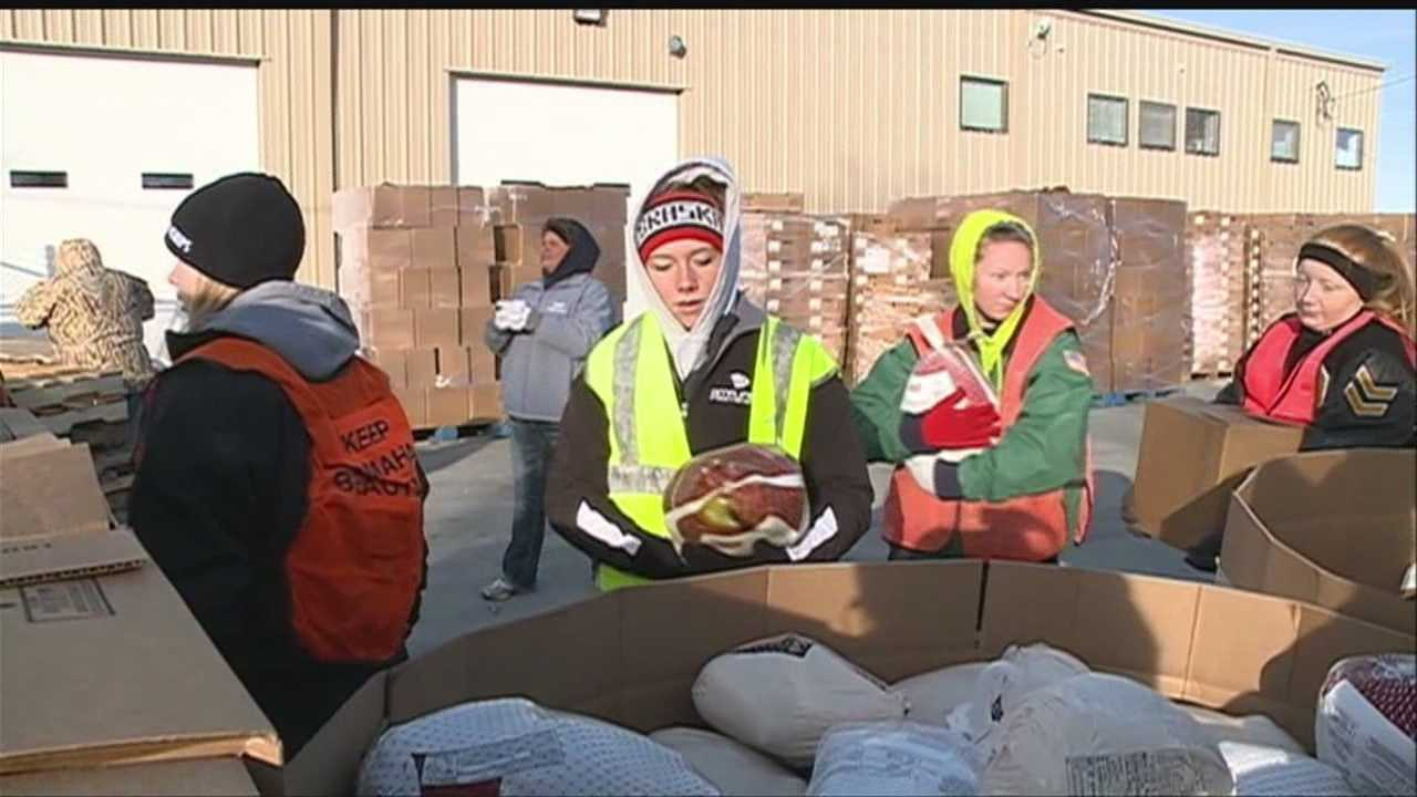 Hundreds of volunteers braved the cold Saturday morning to put together Thanksgiving meals for low-income families.
