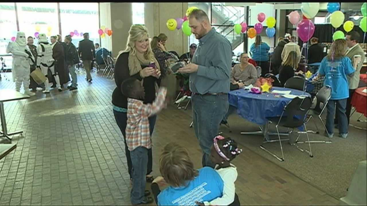 Dozens of area families rejoice Saturday as they welcome new members during National Adoption Day