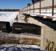You can see a team of rescue workers on the ground pull the rescue worker into the bridge so he can get to the man.