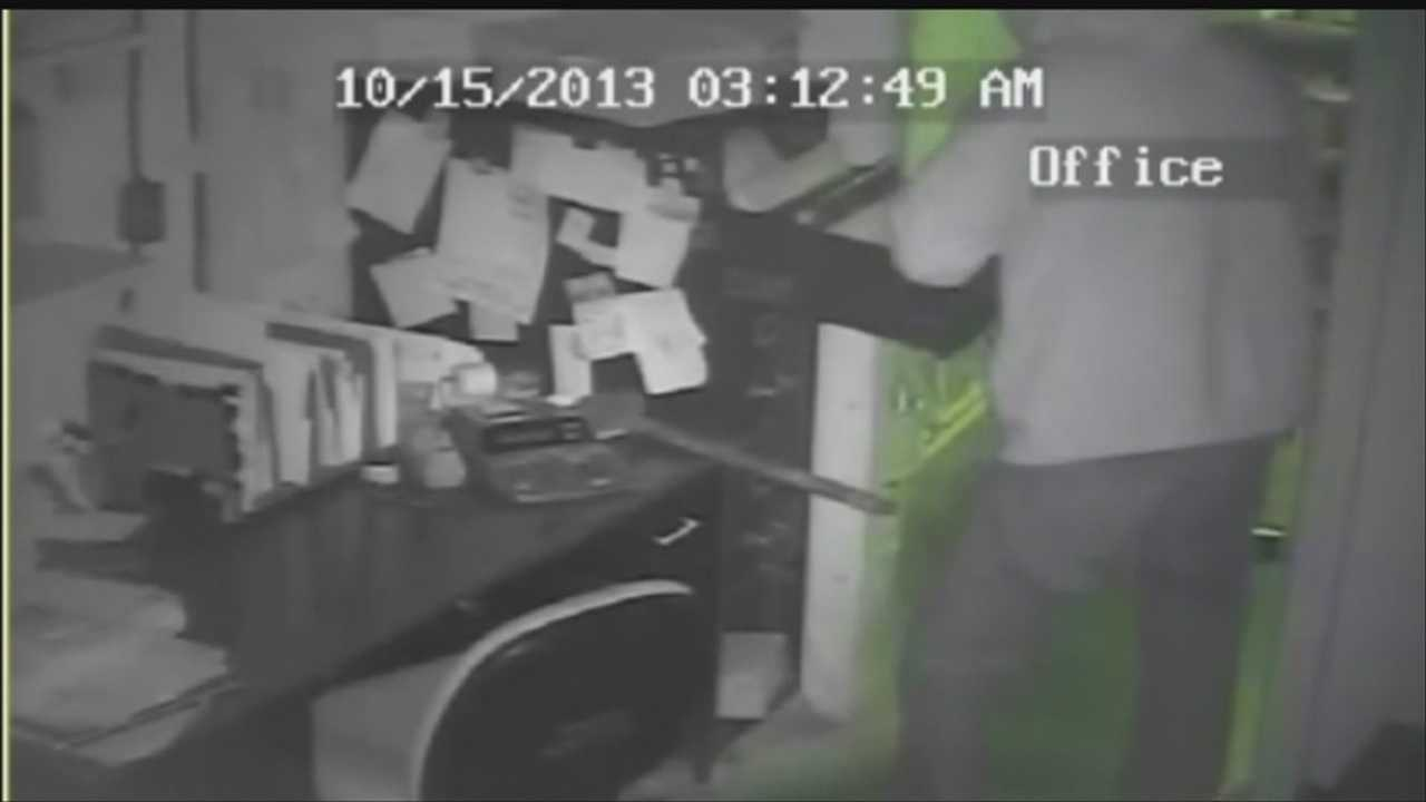 Surveillance video shows a man breaking into Dinker's Bar & Grill on Oct. 15