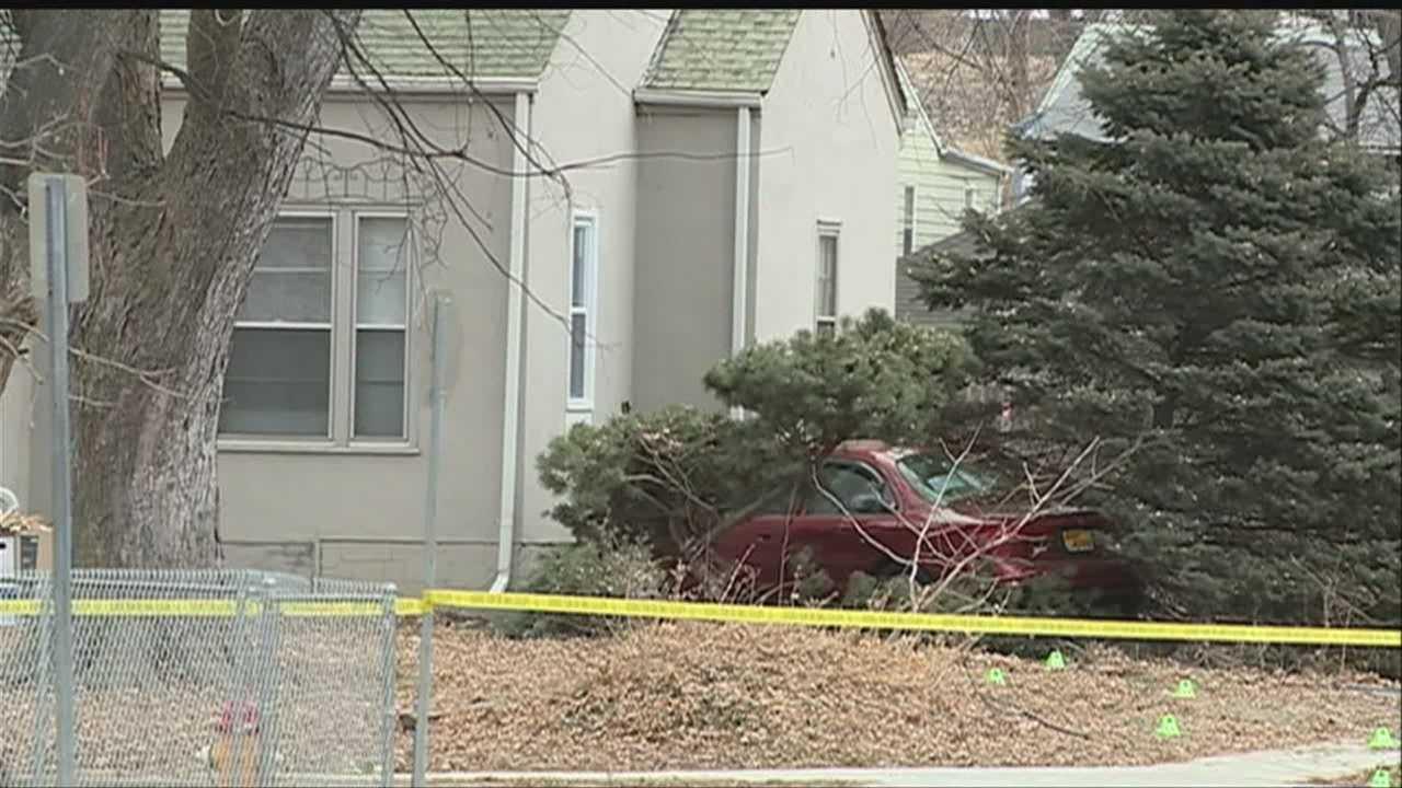 Man killed when car hits Omaha home