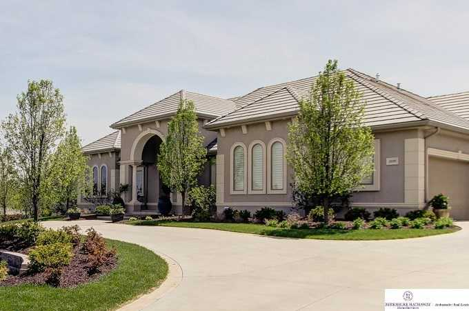 This four-bedroom, six-bathroom west Omaha home boasts an elegant exterior, with luxurious living inside. See the full listing here.