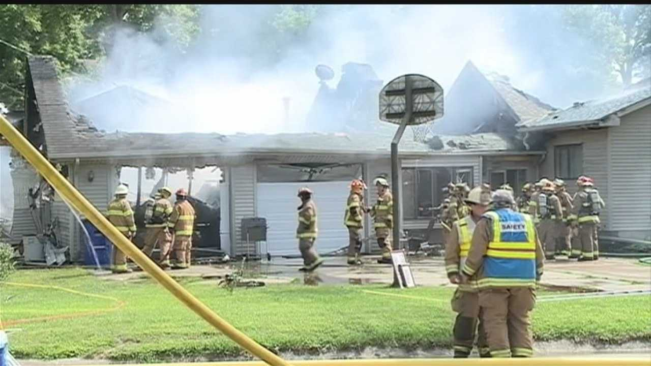 Crews call for backup to knock down a house fire in Louisville on Thursday afternoon.
