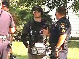 Bryce Dion, seen here in a still image from a KETV July 2014 video, with Omaha police.
