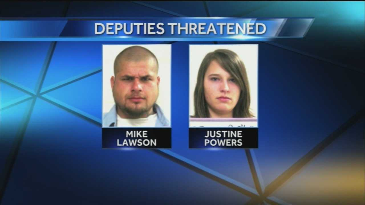 Authorities say two people have been arrested after allegedly making death threats toward three sheriff's deputies.