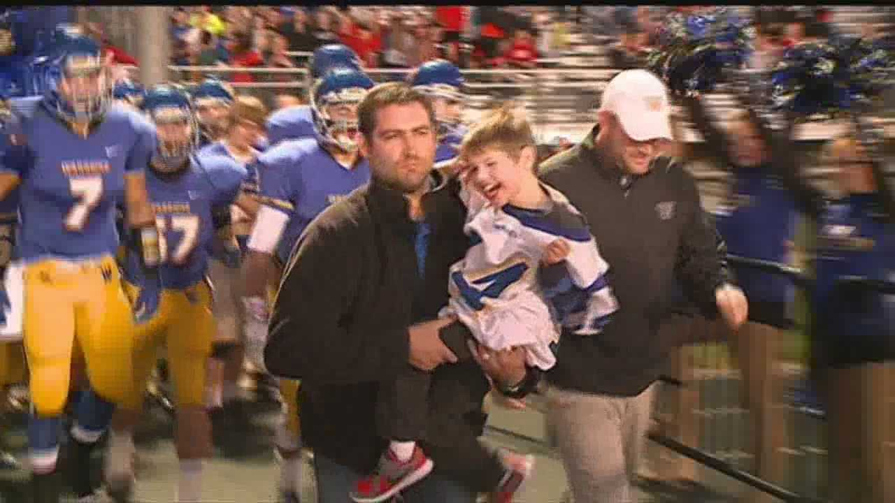 A special member of the Wahoo Warrior family led the team onto the field Friday night.