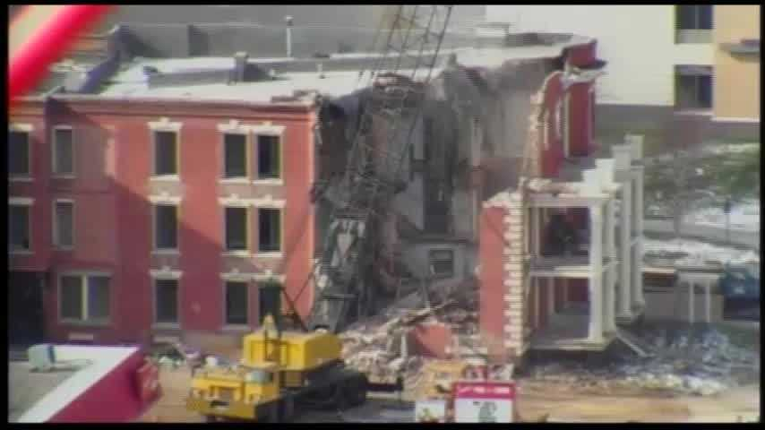 Demolition began on the historic Clarinda-Page building in Midtown Omaha on Thursday.