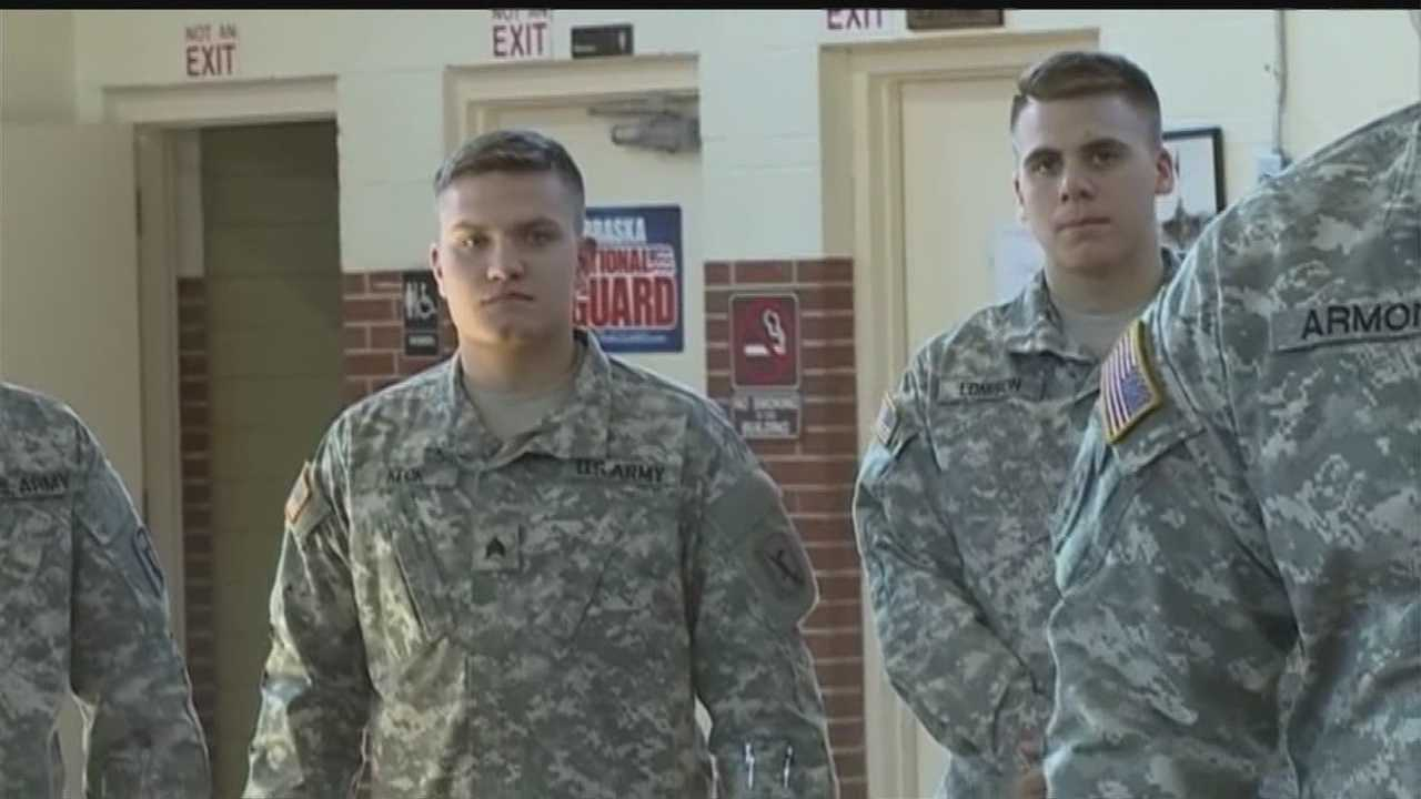 Two students put their education on hold to serve in Qatar with the National Guard for a year.