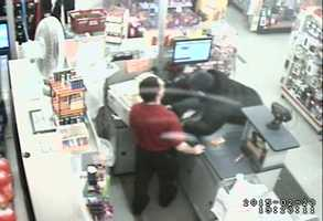 Surveillance image shows Elrod reaching over the counter to grab money, police said.