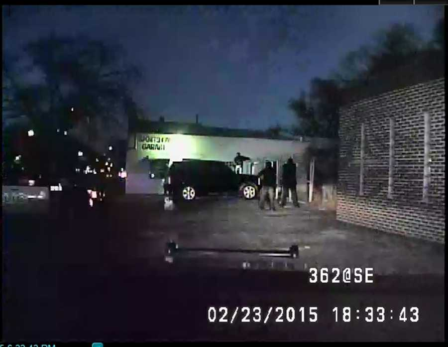 Moments before Officer Alvin Lugod fired his weapon, Elrod is seen standing on top of a vehicle, ignoring commands from officers, police said.