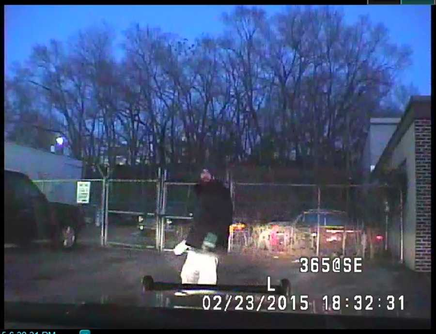 Elrod is seen in cruiser camera video shortly after officers caught up with him a block away from the Family Dollar store, police said.