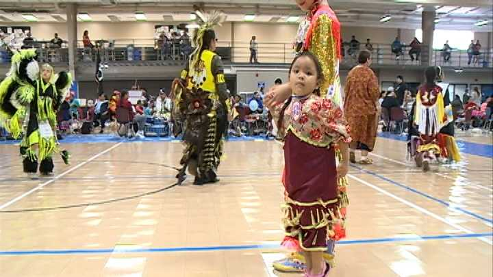 Native American dancers take center stage at the All Nations Pow-Wow Saturday afternoon.