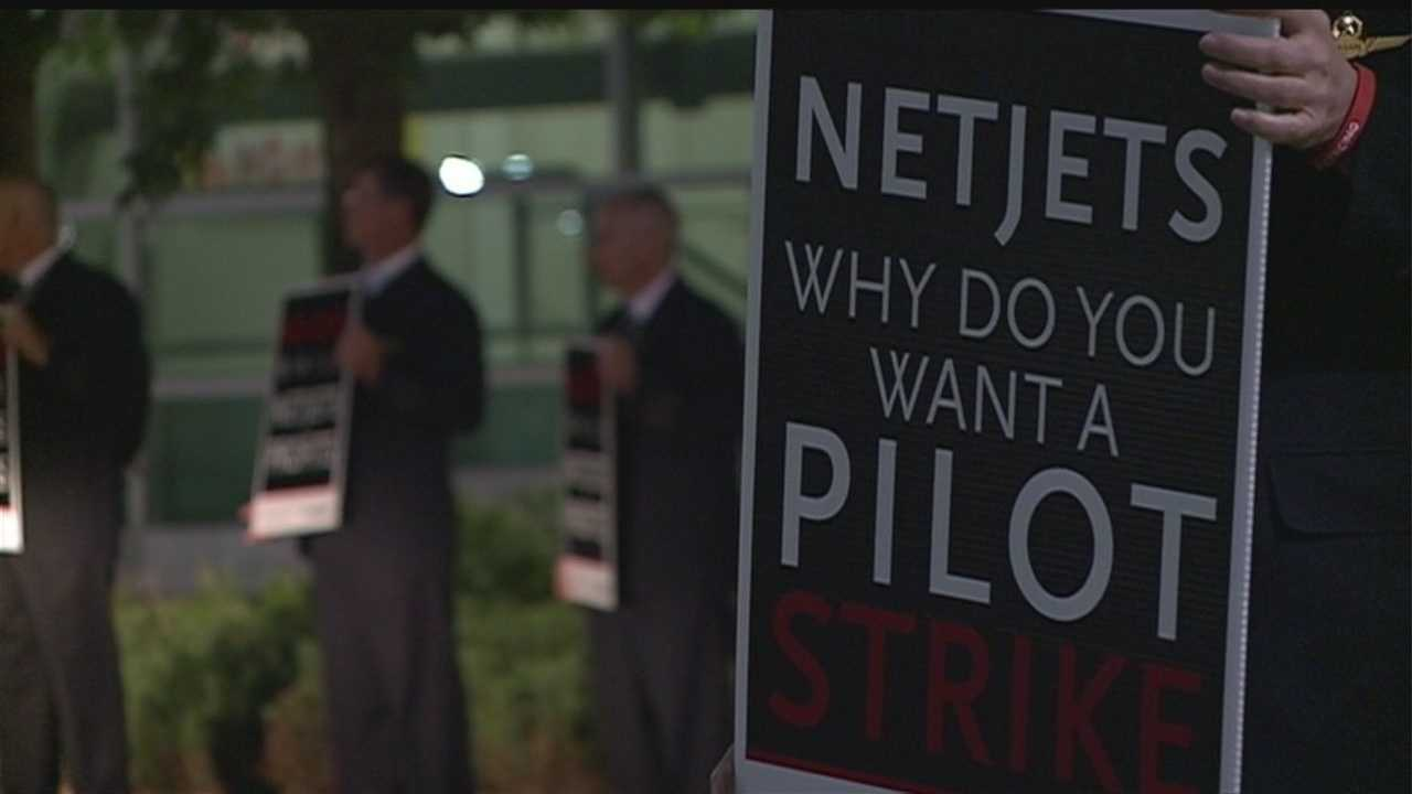 Dozens of NetJets employees are asking shareholders to pressure the board of directors to investigate the treatment of crew members.