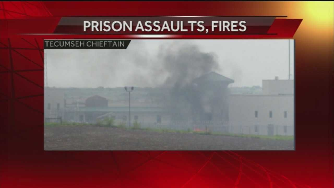 Flames are seen from the Tecumseh State Correctional Institution hours after two inmates were shot -- one with live ammunition, the other with rubber bullets.