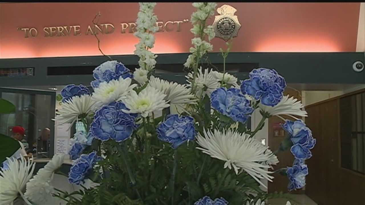 Officer Weise delivered flowers Wednesday to several locations that were meaningful to officer Orozco.