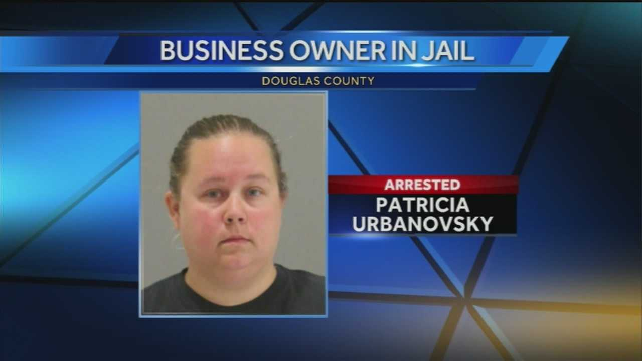 The Creative Creations owner faces three felony counts of deceptions and turned herself in Friday morning.