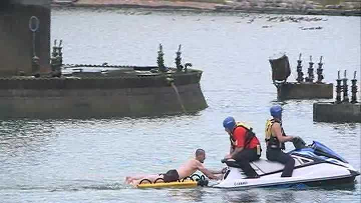 Authorities rescued a man from the center of the Heartland of America Park lagoon