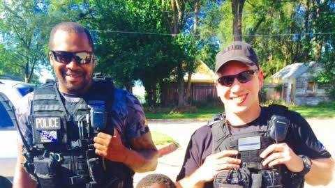 Detectives Robert Wiley and Dale Thomas, who work in Omaha Police Department's gang unit, purchased a new bike and helmet for an Omaha boy this week.